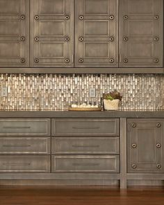 distressed cabinets with an amazing metallic backsplash. Love!
