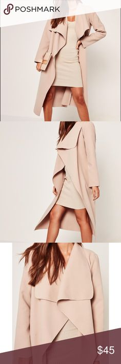 Camel duster coat Gorgeous tan waterfall coat- Missguided camel duster coat. Unfortunately I'm 4'11 so this coat drags on me even with heels. Looks so classy on, amazing color. Never worn, brand new with tags still attached!US size 4 which is equivalent to a small 💕 Missguided Jackets & Coats Pea Coats