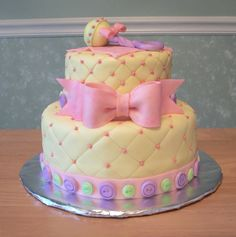 baby shower cake could substitute a blue bow for a boy and a rubber ducky on top