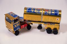 Articulated lorry made of Mobil Super XHP oil cans, with tyres made of pieces of rubber tyre. Collected in Zimbabwe, 1993 (1993.45.1.2)