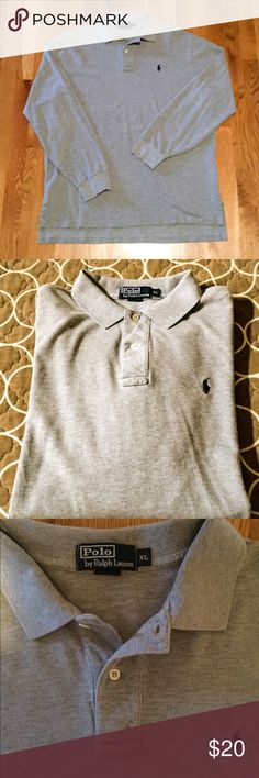 Men's Ralph Lauren Classic Fit Polo Men's Classic Fit Polo Shirt. Excellent used condition. Heather Gray Color. Ribbed Polo collar. Two-button placket. Long sleeves with ribbed armbands. Tennis tail: uneven hem that helps to keep the shirt in place when tucked in. Navy embroidered pony at the left chest. 100% cotton. Machine washable. Smoke/Pet Free 🏡. Polo by Ralph Lauren Shirts Polos