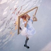 Jumping through a photo frame.    Underwater Photo Shoot