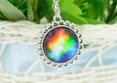 For Sale: #6 Colorful Galaxy and Planet Glass round Pendant silver plating Necklace - #6 Colorful Galaxy and Planet Glass round Pendant silver plating Necklace. New in pkg. 4.00 (cross posted)
