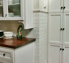 I love the subway tiles that turn the corner and go down to the floor. Can use this in my kitchen!