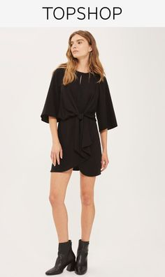 Black mini dress with knot front detail.