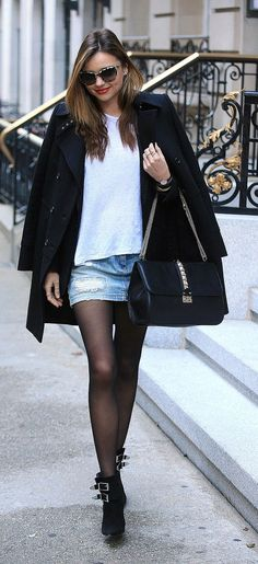 Miranda Kerr Summer street style inspiration:  Even on cooler days a short denim skirt should be a Summer style staple. Miranda paired hers with a slouchy white tee and a black overcoat along with sheer black tights. Ankle boots and a chain-strap bag finished her look off perfectly.