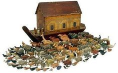 Noahs Ark And Figures Wooden German Circa 1850's.</STRONG> A majestic example of a classic ark, bow bottomed with red / brown painted hull and roof and sliding partial side panel. Door opens to reveal an array of finely crafted creatures including 57 different, matched pairs of animals encompassing elephants, lions, farmyard, birds, wildlife and domestic pets plus over 70 singles. Ark has some rubbing and loss of paintwork overall, side panel is loose, animals are of excellent quality.