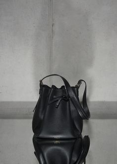• BLACK BUCKET BAG • Timeless bucket bag made out of Italien calf leather. Comes with an extra leather lining pouch to keep your valuables safe. #bucketbag #leather #calf #accessories #bag #handbag #timeless #black #timeless #minimal #reduced #modern #contemporary #fashion #signature #trendy #raellezurich www.raellezurich.com Bag Making, Making Out, Black Bucket, Contemporary Fashion, Calf Leather, Bucket Bag, Calves, Minimal, Pouch