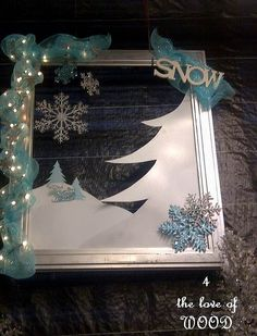 This would be easily replicated with poster board, glitter snowflakes, battery operated lights, etc.