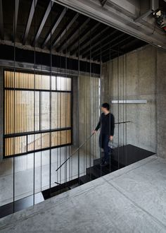 Continuous staircase connects all eight levels of this narrow Kyoto bar