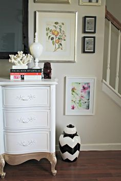 I love that the bottom of this dresser is painted gold! #DIY