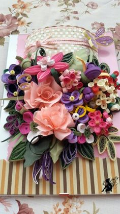 Quilled Spring Basket with Flower Arrangement ~ April 2016 by The Quilling Fairies - Facebook. Quilled Basket with Flower Arrangement on a glass frame. Please visit our page and share if you like! ♡