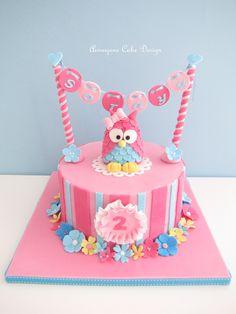 Pink owl 2nd birthday cake with hanging name.  So adorable.