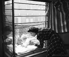 baby cage attached outside window for baby to get natural sunlight