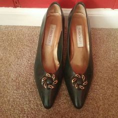 Leather Heels Hunter green leather pump with green and gold accent . Size 10AA. Worn one time. In great condition. This is for narrow feet. Very cute and hard to find color. There is a very faint mark on heels from where they rubbed together. Look at photo #3. Karen Scott Shoes Heels