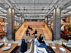 Multifunctional, auditorium-style steps in New York's co-working space Neuehouse, designed by Rockwell Group, are used for meetings, lectures and concerts