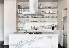 Contemporary kitchen with white cabinets quartz waterfall island and open shelving with glassware dishes Open Shelving, Kitchen Design Small, Kitchen Cabinetry, Open Kitchen Shelves, Contemporary Kitchen, White Kitchen Cabinets, White Cabinetry, Kitchen Styling, Shelving