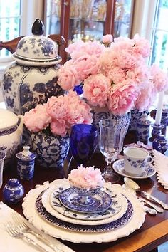 Blue and white china and many pink hydrangeas