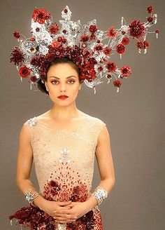 Jupiter Ascending - Mila Kunis as Jupiter Jones wearing a crystal-embellished tulle mermaid-line dress with red crystal flowers. The same flowers can be found in her elaborate headpiece. This dress was custom-made by the designer Michael Cinco. Mila Kunis, Jupiter Jones, Channing Tatum, Jupiter Ascending, Michael Cinco, Beautiful Costumes, Fantasy Costumes, Movie Costumes, Halloween Costumes
