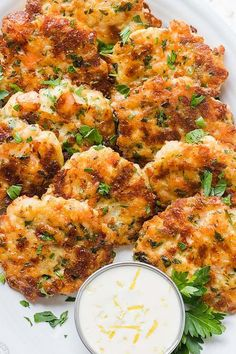 Cheesy Shrimp Fritters with irresistible lemon aioli sauce. One of our favorite shrimp recipes! Biting into juicy shrimp, fritter style, is a real treat. The cheese creates an irresistible cheese pull inside and forms a golden crust on the outside. Fish Recipes, Seafood Recipes, Cooking Recipes, Healthy Recipes, Easy Cooking, Cooking Food, Cooked Shrimp Recipes, Shrimp Dinner Recipes, Frozen Shrimp Recipes