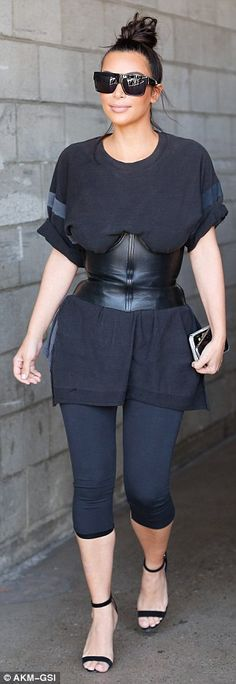 Interesting look: The 35-year-old reality star wore a strange ensemble consisting of a leather corset over a baggy t-shirt