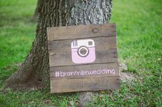 Wood sign with Instagram hashtag for guest photos