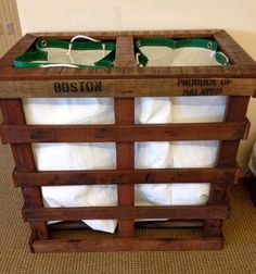 Laundry bin made from two wood pallets