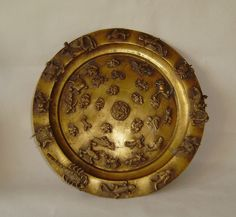 vintage chinese gilt/ tray decorated with animal bird &fish figures in relief