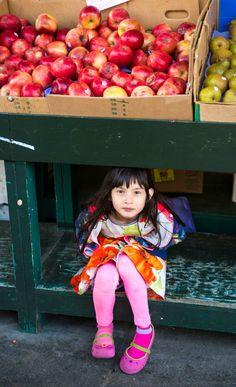 Girl under apples