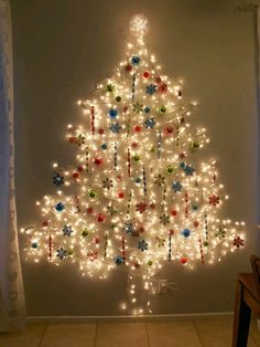 Easy Ideas for Handmade Christmas Decor. Spread holiday cheer with these Wall Christmas Tree - Alternative Christmas Tree Ideas and other holiday ideas. Unusual Christmas Trees, Best Christmas Lights, Wall Christmas Tree, Alternative Christmas Tree, Xmas Tree, Christmas Holidays, Outdoor Christmas, Christmas Movies, Christmas Tree Out Of Lights