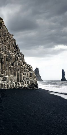 The amazing black sand beach in Vik!  Iceland is one of the most amazing countries in the world to travel to!   Don't miss these top 10 things to do in Iceland!