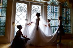Flower girls help prepare a Disney bride for her fairy tale wedding at Disney's Wedding Pavilion