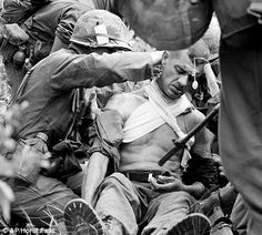 Lt. Col. George Eyster of Florida is placed on a stretcher after being shot by a Viet Cong sniper at Trung Lap, South Vietnam.