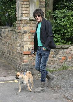 Rolling Stones rocker Ronnie Wood takes a break from hanging out with his uber-young model gal pal to walk his dog in London. Ronnie Wood Art, Rolling Stones Album Covers, Emotional Rescue, David Wood, Ron Woods, Charlie Watts, Greatest Rock Bands, Rhythm And Blues, Keith Richards