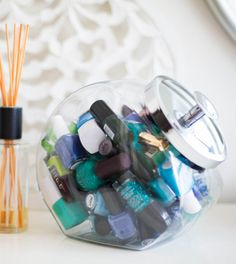 Store your nail polish bottles in a glass cookie jar. Brilliant idea from Cosmopolitan magazine.