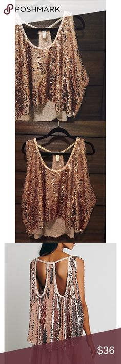 F R E E   P E O P L E Rose gold • Sequins • Cutout back • Oversized fit • Excellent condition • NO TRADES/HOLDS • All reasonable offers accepted • Free People Tops