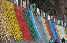 People hang paper cranes designed as prayers for the the souls of victims of the disaster in Minamisanriku, Miyagi prefecture on March 10, 2012. (Kazuhiro Nogi/AFP/Getty Images)