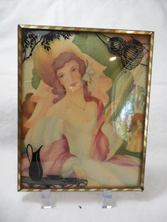 Vintage Reverse Painted Silhouette with Convex Bubble Glass Frame by moonlightmystiques on Etsy https://www.etsy.com/listing/188510225/vintage-reverse-painted-silhouette-with