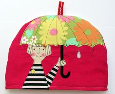 Umbrella Girl Tea Cosy. via Etsy.