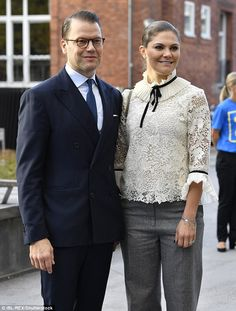 Crown Princess Victoria looked typically elegant in a ruffled lace blouse as she arrived for a health forum in Solna with husband Prince Daniel