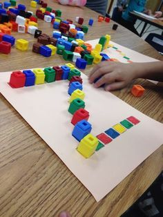 Color recognition, learning patterns, and making letters with unifix cubes. Pre-K literacy or math center activity