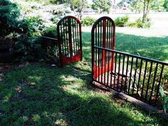 garden gate made from front/back of old crib More