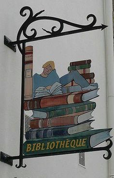 Sign for the Library of La-Roche-Bernard. La-Roche-Bernard is a town in the Brittany Region in north-western France.
