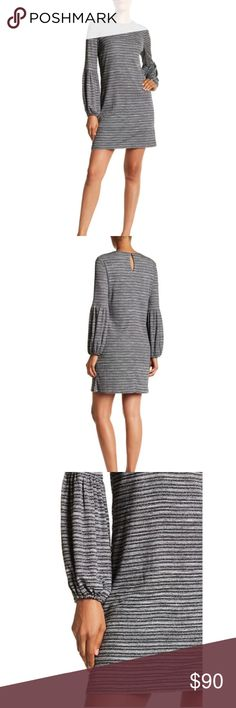 Blouson Sleeve Grey Dress A metallic accented stripe dress with long blouson sleeves looks luxurious yet the knit detail makes it comfortable and laid back.      - Crew neck     - Back keyhole with button closure     - Lined  Fiber Content     Shell: 55% polyester, 29% rayon, 11% nylon, 5% lurex     Lining: 100% polyester Care     Machine wash cold London Times Dresses