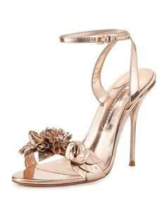 """Sophia Webster metallic calf leather sandal. 4.3"""" covered heel. Strap with 3D floral-appliqus bands open toe. Adjustable ankle strap. Leather outsole. """"Lilico"""" is made in Brazil."""