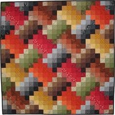 """Quilt by Kay Koeper Sorensen: """"Each unit of color tessellates in this quilt. Each unit is made up of 18 shaded squares of a color. I wanted this quilt to be square so there are partial units along the edges."""""""