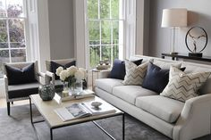Aldeco's fabric Zoom (Colour Opal Grey C1) featured on the scatter cushions of a Chelsea Terrace reception room designed by th2designs