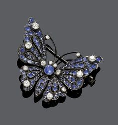 SAPPHIRE DIAMOND BUTTERFLY BROOCH.  White gold.  Set with blue sapphires light, weighing approximately 2:00 CT and 14 brilliant-cut diamonds, total ling approximately 0:40 CT. Approximately 3.7 x 3.2 cm.
