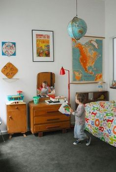 I am in love with vintage themed kid & nursery rooms. I want the ABC fabric on the bed!