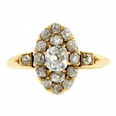 Victorian Oval Diamond Cluster Ring::centering an Old Mine cut diamond weighing app. 0.48ct., framed by sixteen Old Mine cut diamonds (two on shoulders), weighing app. 0.81ctw., fashioned in 18k. Circa 1890. Size 6.25